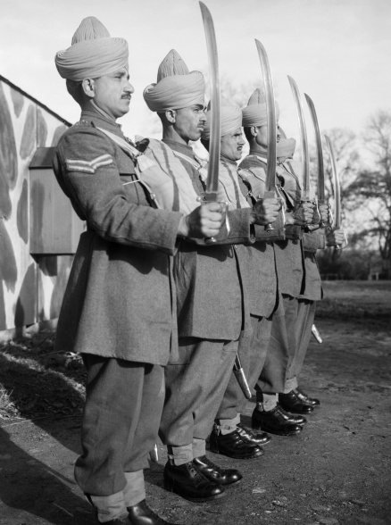Name:  Mule_handlers_of_the_Royal_Indian_Army_Service_Corps_parade_with_drawn_swords,_16_November_1940..jpg